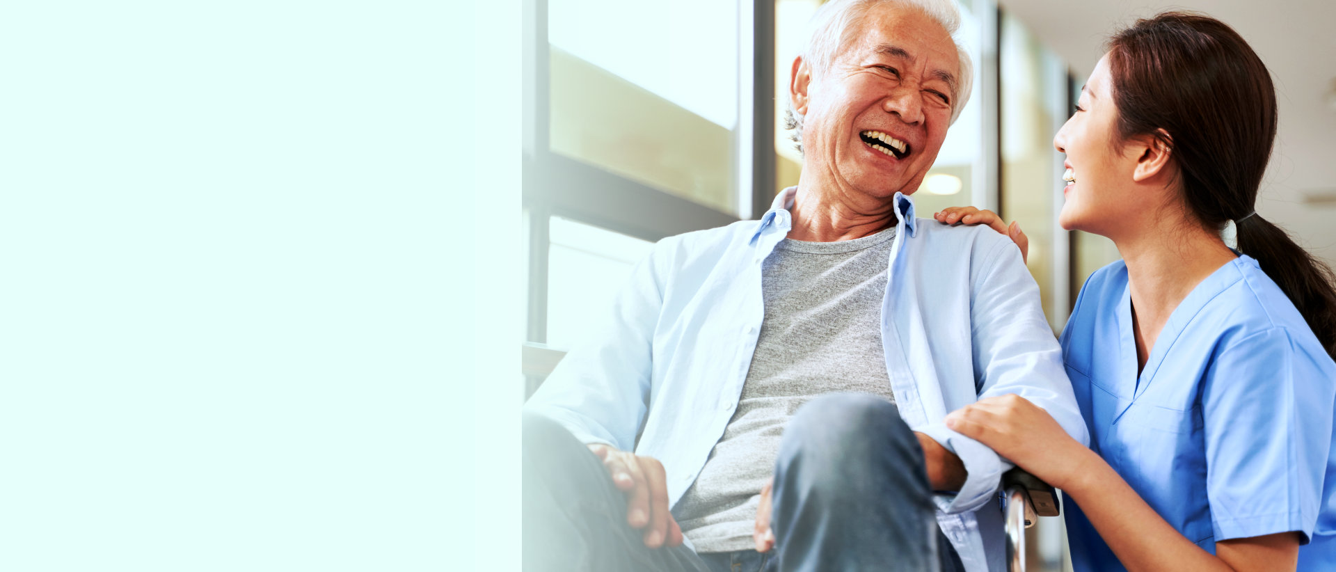 an elderly man and a caregiver smiling